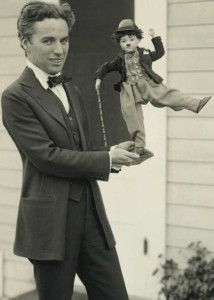 http://upload.wikimedia.org/wikipedia/commons/e/e7/Charlie_Chaplin_with_doll.jpg